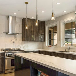 Contemporary kitchen with open shelving and custom finishes