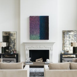 Sophisticated family room with glamorous accents and bold art