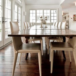 The dining table is a traditional parquet table and paired with Bottega chairs.