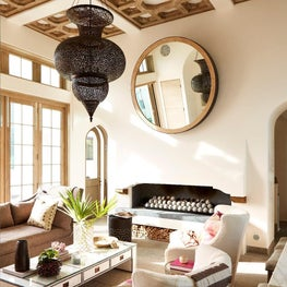 Custom details: fireplace, wood & plaster ceiling, and Moroccan light at Living