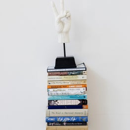 Stack of Books and a Knickknack