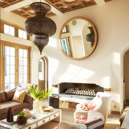 Warm transitional living room with fireplace and wood coffered ceiling