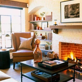 A blazing fireplace adds warmth to this sophisticated family room.