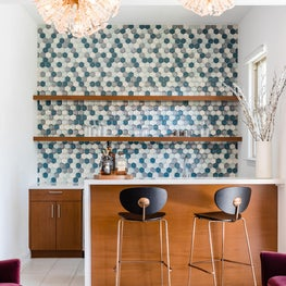 Home bar with eclectic tiling backsplash and multiple gold star chandeliers