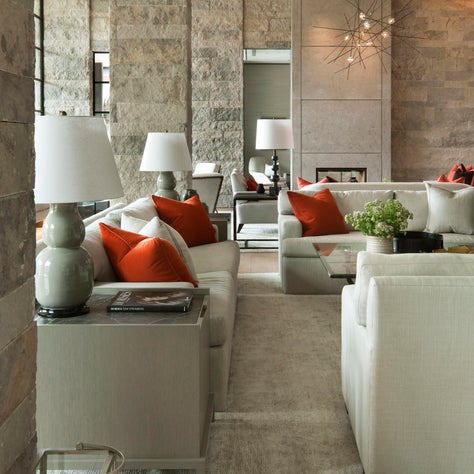 Monochromatic Living Room with Stone Walls and Wood Detailed Ceilings