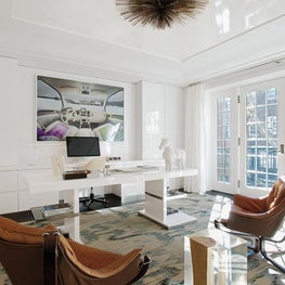 Office with cream and blue Ikat carpet by Stark, vintage Sigurd Ressel armchairs, and clean, custom white desk