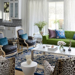 Art Deco living room, green sofa and leopard print chairs