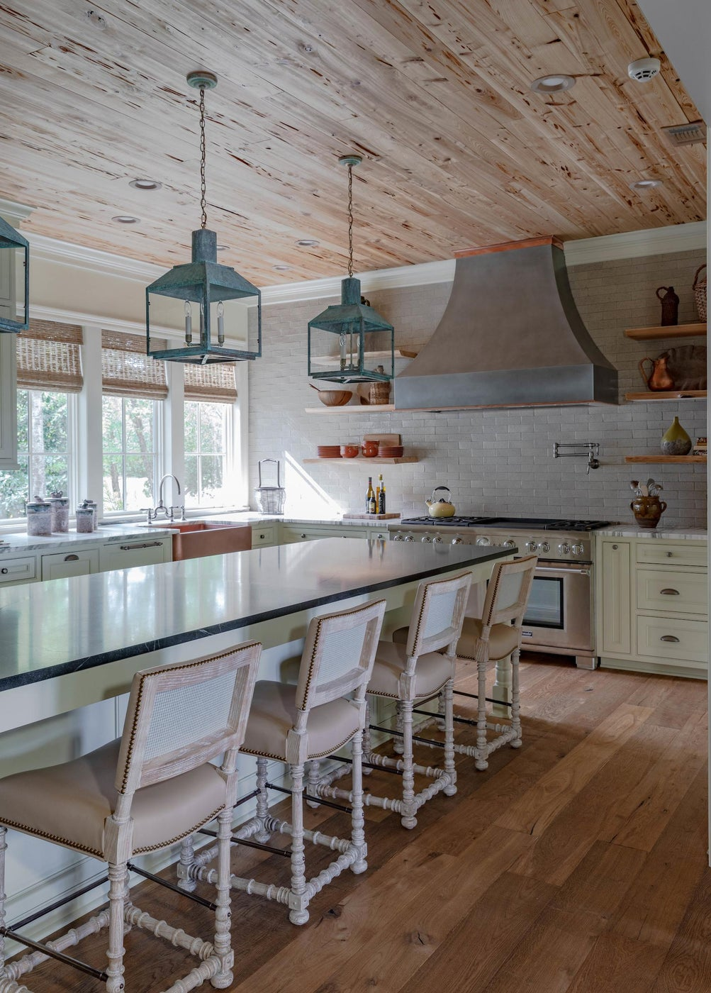 Country House kitchen features pecky cypress on the ceiling