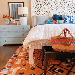 Bohemian bedroom with carved headboard