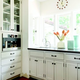 Kitchen pantry with corbeled arches, bay windows, and built-in coffee station