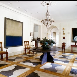 Foyer with modern art, geometric wood and stone floors