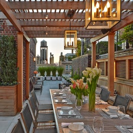 City terrace with alfresco dining and contemporary pergola