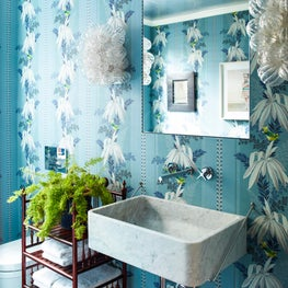 Powder room with blue, floral wallpaper