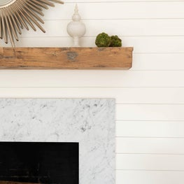 A mantle refresh with ship lap, new stone surround and antique beam