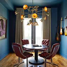 It's all about rock n' roll in this performer's breakfast nook featuring music memorabilia, vintage furnishings, and an Italian trumpet chandelier.