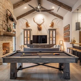 This trophy and game room sports a custom designed bar and metal laminate wall