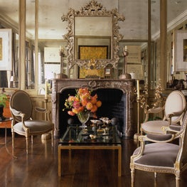 A mix of antiques with contemporary furniture and artwork make a chic statement.