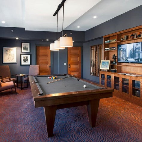 A navy and wood billiards room for a Tibecca home