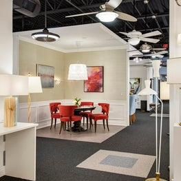 Lighting Showroom Design in Philadelphia Features Red Dining Chairs