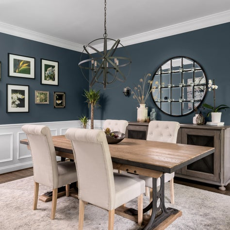Eclectic Dining Room with Blue Walls and Industrial Elements.