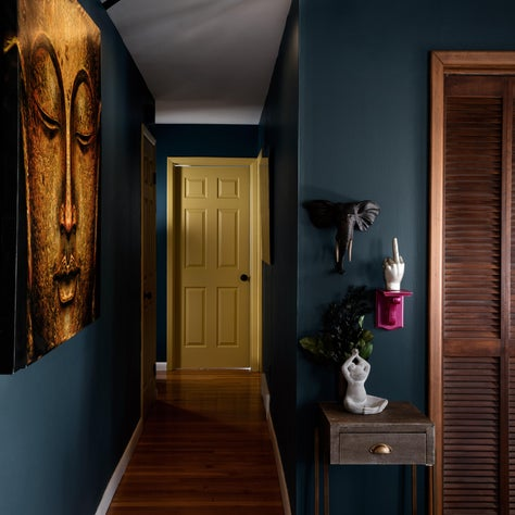 NYC apartment with dark walls, pattern painted ceilings and bold artwork.
