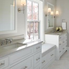 Sunfilled Jack & Jill bath, marble herringbone floor, custom cabinet, bench seat