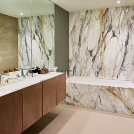 InSpace NY decors with grand marble baths by Rem Koolhaas