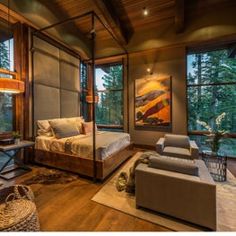 Master bedroom with custom canopy bed, sitting area, and mountain views