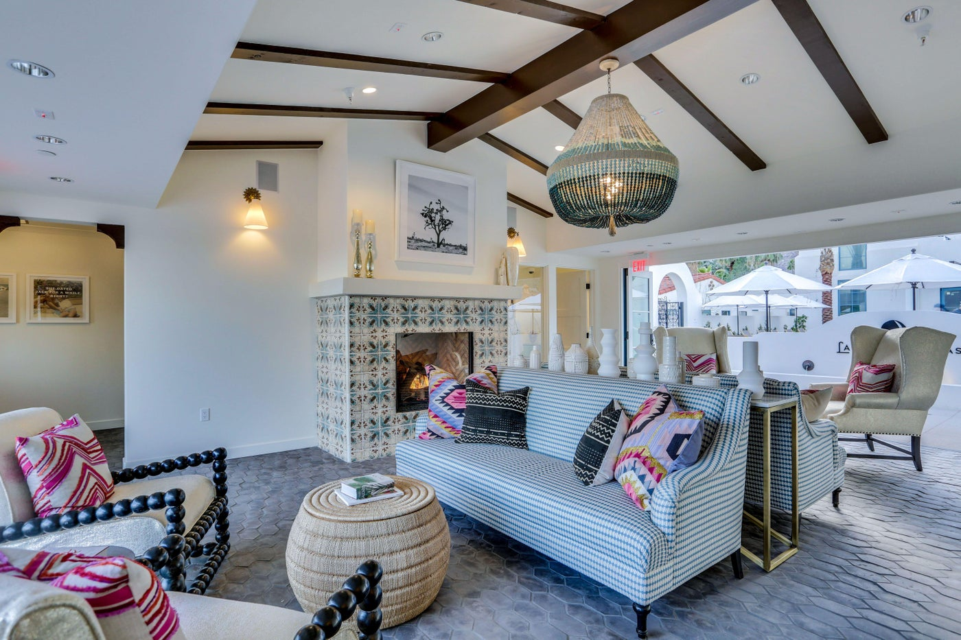 Entry lobby with custom pendant and fireplace at Palm Springs La Serena Villas