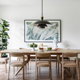 White wall dining room with Case dining table and Thomas O'Brien pendant light