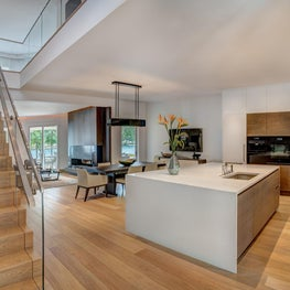 Large, open kitchen area in modern lake front home.