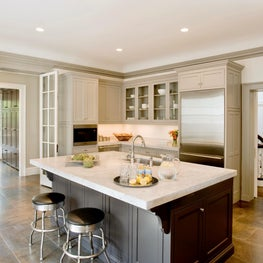 Classic taupe kitchen with gray carrara marble island