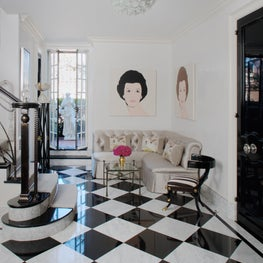Foyer with Andy Warhol double-portraits over banquette, French doors lead to East River terrace