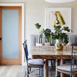 Sunny Dining room with Custom Burl Wood Table and Vintage French 1950s Chairs