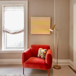KIngston Designer Showhouse 2019 - A bright BluDot red velvet chair adds a whimsical splash of color against a neutral backdrop