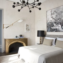Paris classic + futuristic pied à terre with custom Deniot fireplace and bedding