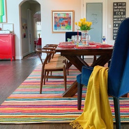 Colorful dining room with mixed chairs