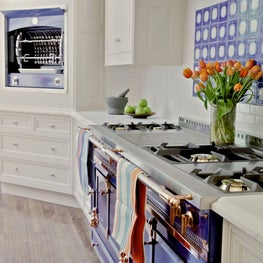 Updated traditional kitchen with indigo range and handmade backsplash tile