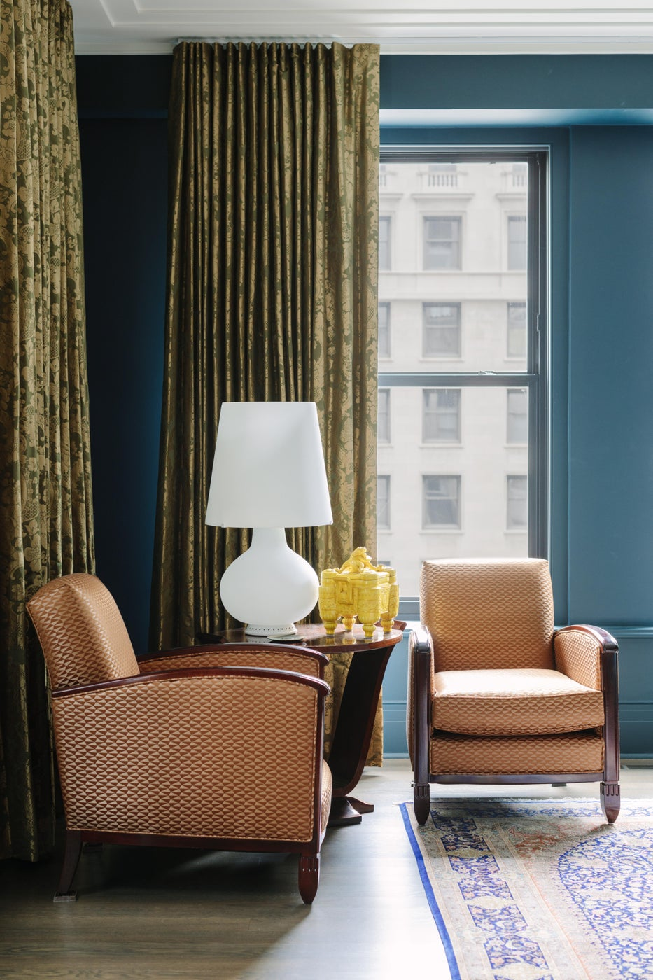 Art Deco Bedroom with teal walls, patterned silk drapes, and Chinese silk rug