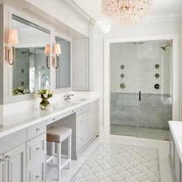 Master bath, mosaic tile, luxurious shower, crystal chandelier, deck mounted tub