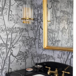 Powder room with custom marble top vanity and Cole and Son wall coverings