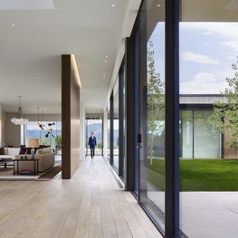 Expansive Windows opens this Hallway and Great Room to the Exterior.