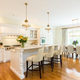 Georgian inspired white kitchen using mixed metals and elegant gilt lighting from Circa.
