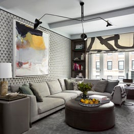 Graphic and playful family room with printed grasscloth wallpaper