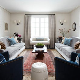 Central Park Living Room with Gray Sofas, Vintage Rug and Live Edge Table