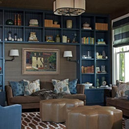 Lake Michigan Den Blue shelving Moroccan Rug Vintage pieces Custom Sofas