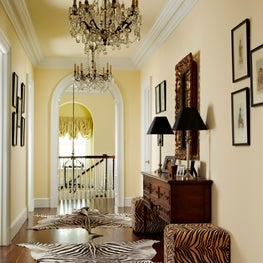 Animal prints and dark wood are contrasted against a subtle yellow backdrop.