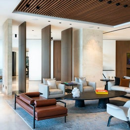 Wood paneled ceiling in this minimalist modern living room.