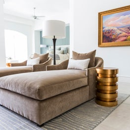 Master suite featuring large sumptuous lounges in contemporary-style home