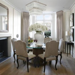Elegant London townhouse dining room with wooden floor, custom made dining table